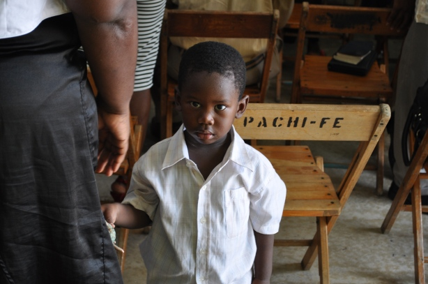 A Haitian boy attends church in Curacao.