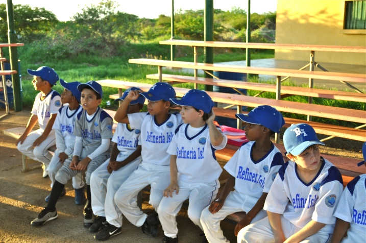 The members of one of Willemstad's little league baseball teams get ready to start their evening practice.
